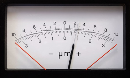 sceince: Rectangular measurement device with a pointer indicator, showing positve numbers, retro style