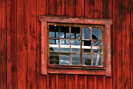 red barn: Broken window in red barn wall