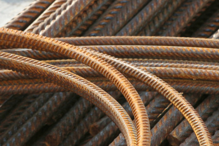 A pile of rusty, bent and straight rebar