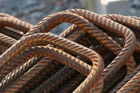 corode: A pile of rusty, bent and rebar