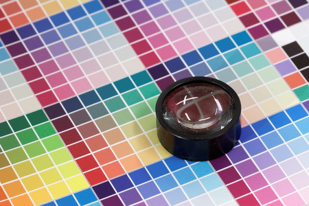 Magnifying glass on a very colorful test print photo