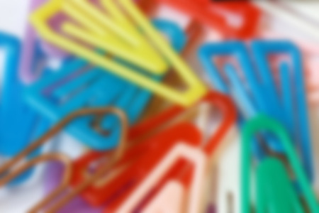 de focused: De focused close up of colorful disarranged paper clips from above as background