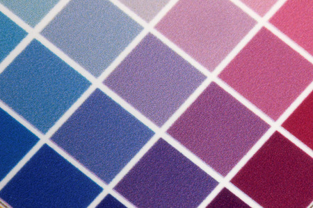 gravure: Close-up of a a test print with many color squares in shades of blue, cyan and violet