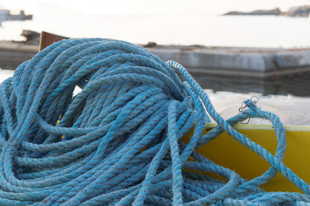 nylon string: Pile of blue nylon rope in the harbor