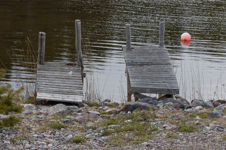 Two small gray bridges and a red buoy in the archipelago photo