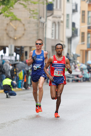 est: STOCKHOLM - MAY 30, 2015: Dadafo Dhaqabi Tesama (NOR) and Kaupo Sasmin (EST) struggeling in the rain after 15 km in the ASICS Stockholm Marathon event May 30, 2015 in Stockholm, Sweden