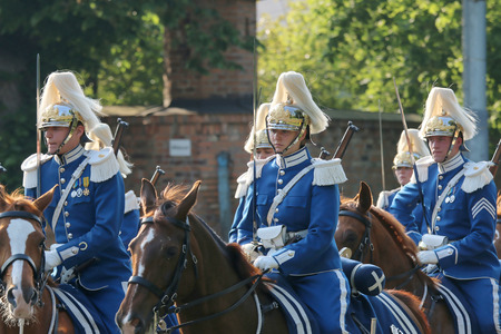carl: STOCKHOLM - JUN 06, 2015: The Royal guards on the horse back protecting the swedish royal family on their way to celebrate the swedish national day Editorial