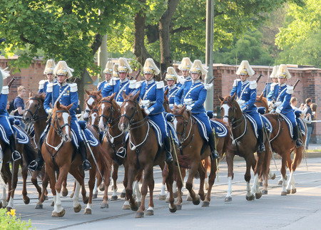STOCKHOLM - JUN 06, 2015: The Royal guards on the horse back protecting the swedish royal family on their way to celebrate the swedish national day Editorial