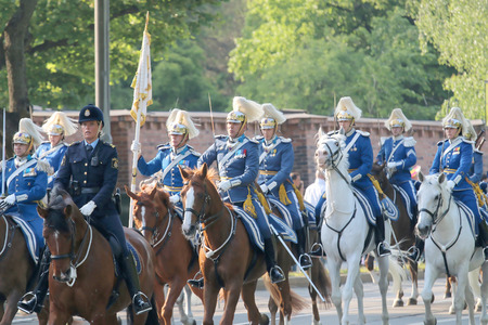 STOCKHOLM - JUN 06, 2015: The Royal guards and the police on the horse back protecting the swedish royal family on their way to celebrate the swedish national day