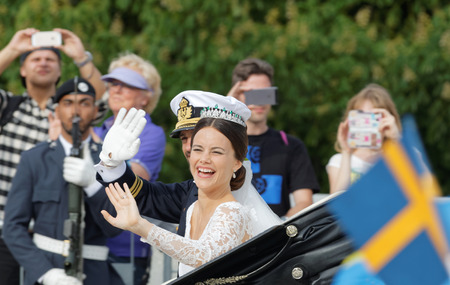royal wedding: STOCKHOLM - JUN 13, 2015: The swedish Prince Carl-Philip Bernadotte and his wife Princess Sofia Hellqvist a few minutes after the royal wedding laughing and waiving to the audience