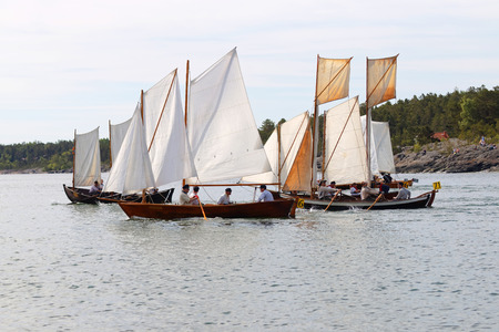 rapidly: GRISSLEHAMN - JUN 13, 2015: Group of small, old sailing ships rowing rapidly from Grisslehamn (Sweden) to Eckerö (Åland) in the public event Postrodden, June 13, 2015 in Grisslehamn, Sweden Editorial