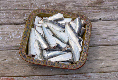 gutted: A bowl full of gutted baltic herring standing on a wooden bridge