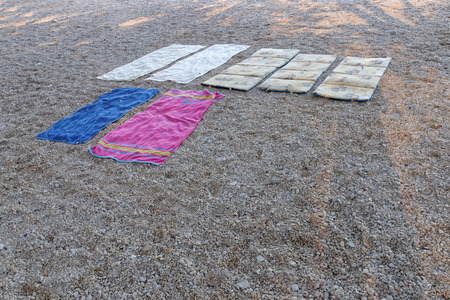 differnt: Seven blankets with differnt colors and textures on the beach. Used to book the best places on the beach