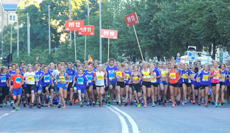 13 year old: STOCKHOLM, SWEDEN - AUG 15, 2015: Large group of 13 year old girls and boys starting in the running event Midnattsloppet, August 15, 2015 in Stockholm, Sweden