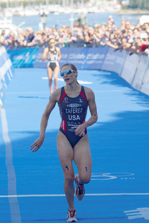 medalist: STOCKHOLM - AUG 22, 2015: Katie Zaferes the silver medalist passing the finnish line in the Womens ITU World Triathlon series event August 22, 2015 in Stockholm, Sweden Editorial