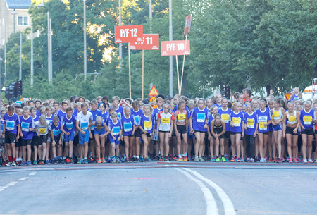 13 year old: STOCKHOLM, SWEDEN - AUG 15, 2015: Large group of 13 year old girls and boys before the start of the running event Midnattsloppet, August 15, 2015 in Stockholm, Sweden