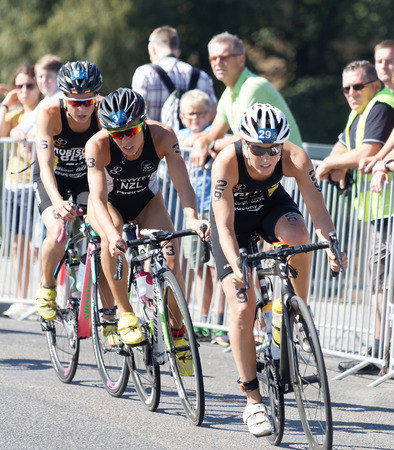 STOCKHOLM - AUG 22, 2015: Triathlete Anja Knapp (GER) cycling, followed by Andrea Hewitt and Rebecka Robisch in the Womens ITU World Triathlon series event August 22, 2015 in Stockholm, Sweden Editorial