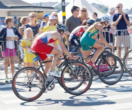 valentina: STOCKHOLM - AUG 22, 2015: Triathletes Valentina Zapatrina, Emma Jackson and Vendula Frintova cycling in the Womens ITU World Triathlon series event August 22, 2015 in Stockholm, Sweden