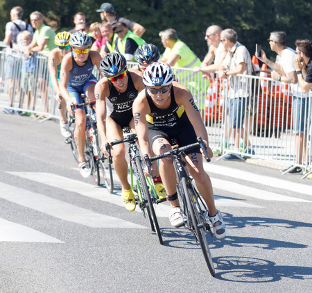 STOCKHOLM - AUG 22, 2015: Triathlete Anja Knapp (GER) cycling, followed by Andrea Hewitt and competitors in the Womens ITU World Triathlon series event August 22, 2015 in Stockholm, Sweden