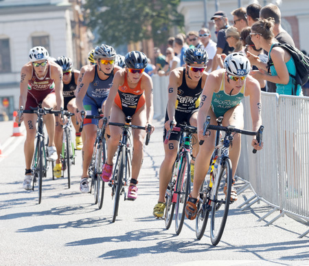 triathlete: STOCKHOLM - AUG 22, 2015: Triathlete Gillian Backhouse (AUS) cycling a curve, followed by competitors in the Womens ITU World Triathlon series event August 22, 2015 in Stockholm, Sweden Editorial