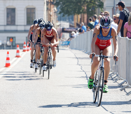 esp: STOCKHOLM - AUG 22, 2015: Triathlete Carolina Routier (ESP) cycling, followed by competitors in the Womens ITU World Triathlon series event August 22, 2015 in Stockholm, Sweden