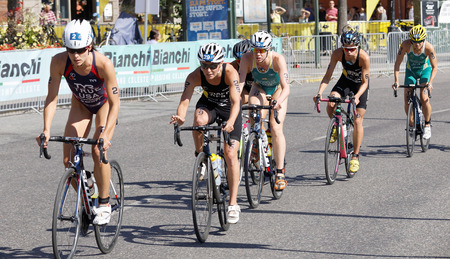 STOCKHOLM - AUG 22, 2015: Triathlete Sarah True leading a group of cyclists in the Womens ITU World Triathlon series event August 22, 2015 in Stockholm, Sweden