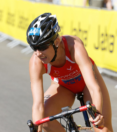 peron: STOCKHOLM - AUG 22, 2015: Close-up of triathlete Gaia Peron (ITU) cycling in the Womens ITU World Triathlon series event August 22, 2015 in Stockholm, Sweden