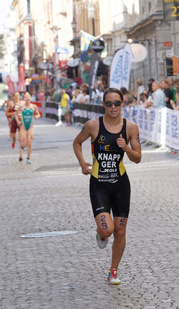 anja: STOCKHOLM - AUG 22, 2015: Triathlete Anja Knapp running and followed by competitors in the Womens ITU World Triathlon series event August 22, 2015 in Stockholm, Sweden