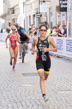 STOCKHOLM - AUG 22, 2015: Triathlete Anja Knapp running, followed by Gaia Peron in the Womens ITU World Triathlon series event August 22, 2015 in Stockholm, Sweden