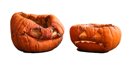 pumpkin carving: Two isolated aged pumkins