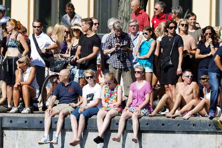 swim race: STOCKHOLM - AUG 22, 2015: Audience on the quay watching the swim race in the Womens ITU World Triathlon series event August 22, 2015 in Stockholm, Sweden Editorial