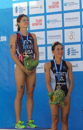 woman squirt: STOCKHOLM - AUG 22, 2015: Sarah True and Andrea Hewitt on the winners stand in the Womens ITU World Triathlon series event August 22, 2015 in Stockholm, Sweden Editorial