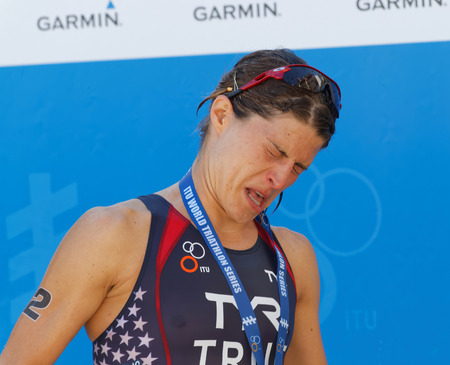shutting: STOCKHOLM - AUG 22, 2015: Sarah True getting champagne in her eyes during the prize ceremny in the Womens ITU World Triathlon series event August 22, 2015 in Stockholm, Sweden