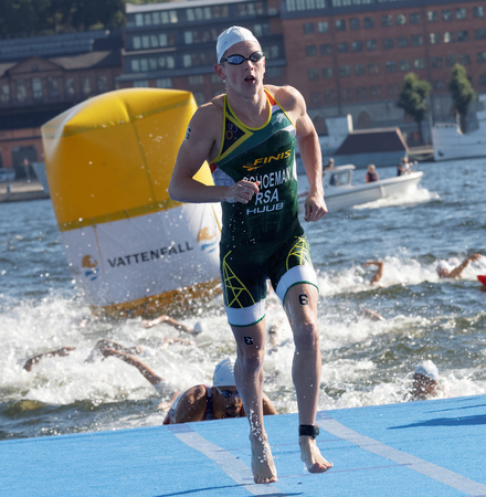 rsa: STOCKHOLM - AUG 22, 2015: Swimmer Henri Schoeman (RSA) climbing up from the water in the Mens ITU World Triathlon series event August 22, 2015 in Stockholm, Sweden