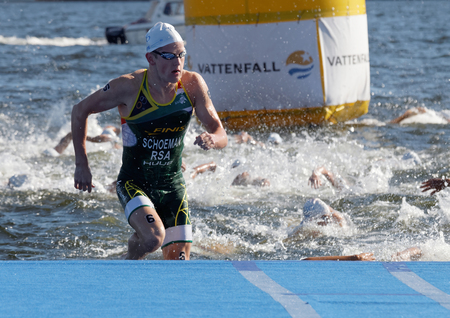 STOCKHOLM - AUG 22, 2015: Swimmer Henri Schoeman (RSA) climbing up from the water in the Mens ITU World Triathlon series event August 22, 2015 in Stockholm, Sweden