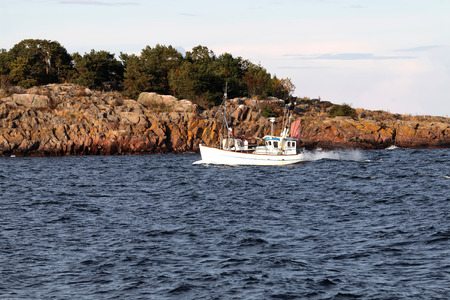 fishingboat: Small fishing boat used for cod fishing in front of an island in the swedish archipelago