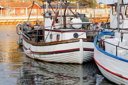 fishingboat: Small fishing boats used for cod fishing in the harbor in the swedish archipelago