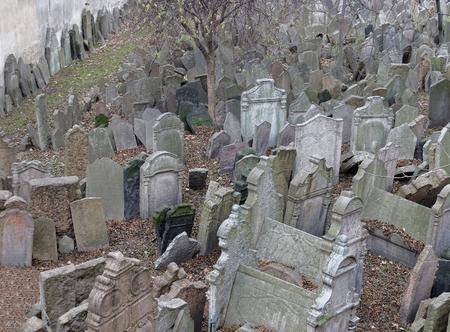 hebrew script: PRAGUE, CZECHIA - DEC 04, 2015: Old Jewish cemetery with lots of ancient headstones. December 04, 2015 in Prague, Czechia