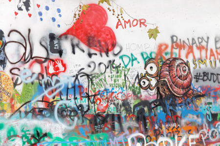 john lennon: PRAGUE, CZECHIA - DEC 05, 2015: The colorful public John Lennon Wall where there is a continous graffiti painting going on by tourists. December 05, 2015 in Prague, Czechia Editorial