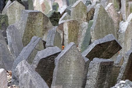 headstones: PRAGUE, CZECHIA - DEC 04, 2015: Old Jewish cemetery, close-up of ancient headstones. December 04, 2015 in Prague, Czechia