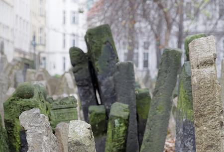 headstones: PRAGUE, CZECHIA - DEC 04, 2015: Old Jewish cemetery, close-up of ancient headstones. Short depth of focus. December 04, 2015 in Prague, Czechia
