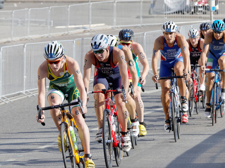 henri: STOCKHOLM, SWEDEN - AUG 23, 2015: Henri Schowman (RSA) land Ben Kanute (USA) leading a group of male cycling triathlon competitors in the Mens ITU World Triathlon series event August 23, 2015 in Stockholm, Sweden Editorial
