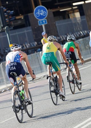 silva: STOCKHOLM - AUG 23, 2015: Rear view male cycling triathlon competitors Kempers, Good and Silva in the Mens ITU World Triathlon series event August 23, 2015 in Stockholm, Sweden