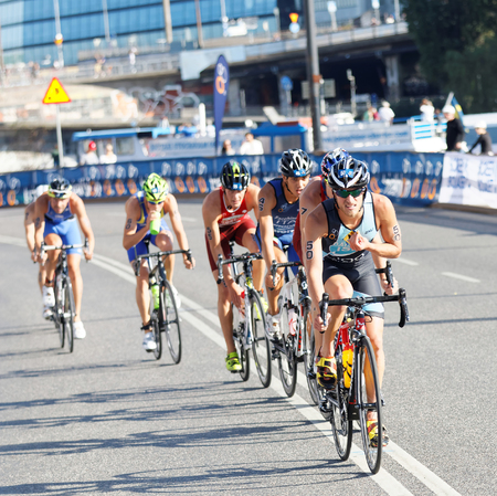 ron: STOCKHOLM, SWEDEN - AUG 23, 2015: Ron Darmon and a group of triathletes cycling in the Mens ITU World Triathlon series event August 23, 2015 in Stockholm, Sweden