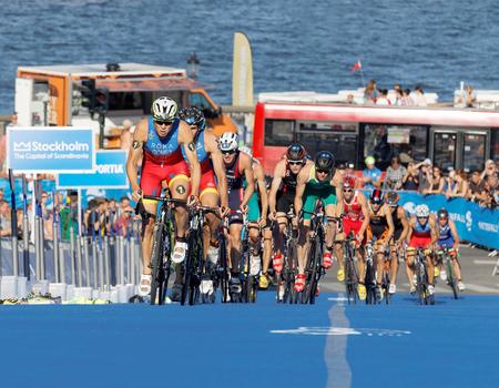gomez: STOCKHOLM, SWEDEN - AUG 23, 2015: Spanish triathlon competitors Javier Gomez Noya and Vincente Hernandez cycling uphill in the Mens ITU World Triathlon series event August 23, 2015 in Stockholm, Sweden