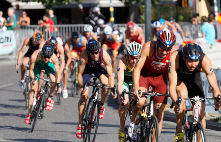 STOCKHOLM, SWEDEN - AUG 23, 2015: Large group of muscular cycling triathlon competitors fighting in the Mens ITU World Triathlon series event August 23, 2015 in Stockholm, Sweden