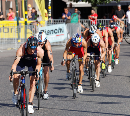 mario: STOCKHOLM, SWEDEN - AUG 23, 2015: Close-up of Mario Mola and a group of cycling triathlon competitors in the Mens ITU World Triathlon series event August 23, 2015 in Stockholm, Sweden