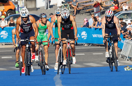 silva: STOCKHOLM, SWEDEN - AUG 23, 2015: Close-up of cycling triathletes Joao Silva, Wynngard, Sandor surrounded by other competitors in the Mens ITU World Triathlon series event August 23, 2015 in Stockholm, Sweden