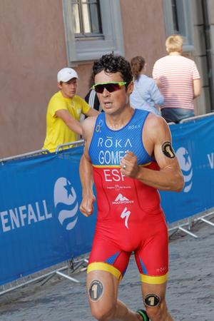 gomez: STOCKHOLM, SWEDEN - AUG 23, 2015: Triathlete Javier Gomez wearing colorful clothes running in the sunshine in the Mens ITU World Triathlon series event August 23, 2015 in Stockholm, Sweden