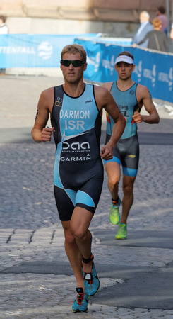 ron: STOCKHOLM, SWEDEN - AUG 23, 2015: Triathlete Ron Darmon  running wearing sun glasses in the Mens ITU World Triathlon series event August 23, 2015 in Stockholm, Sweden Editorial